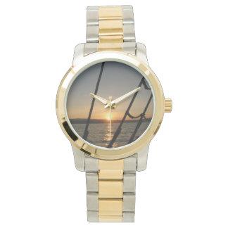 Coucher du soleil par la montre de calage montres cadran
