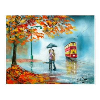 Couples romantiques de parapluie rouge de tram carte postale