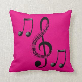 Coussin rose de décor de note de musique