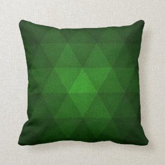 Coussin vert abstrait de triangles