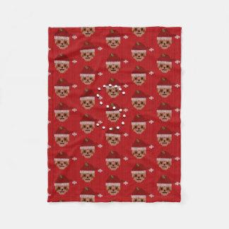 Couverture confortablement rouge d'ouatine de