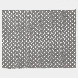 Couverture Polaire Silhouettes blanches de Schnauzer sur le gris de