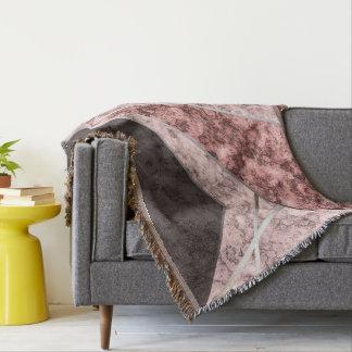 Couvertures Motif combiné gris rose.