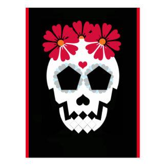 Crâne avec la carte postale de fleurs