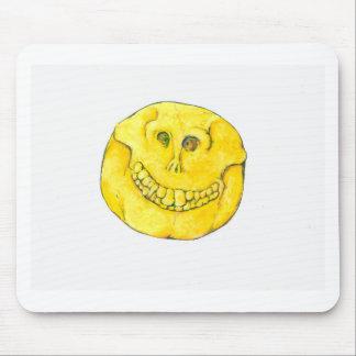 Crâne souriant de visage tapis de souris