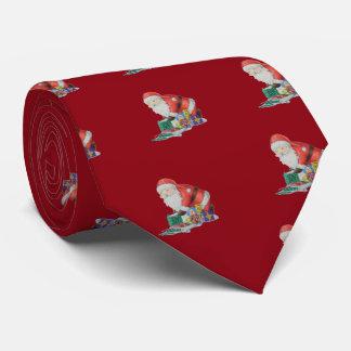 Cravate Père Noël mignon et jouets enveloppant des cadeaux