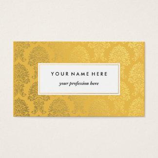 Damassé d'or sur le carte de visite de motif d'or