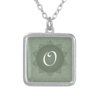 Damassé verte avec l initiale bijouterie