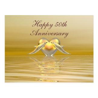 Dauphins et coeur d'or d'anniversaire carte postale