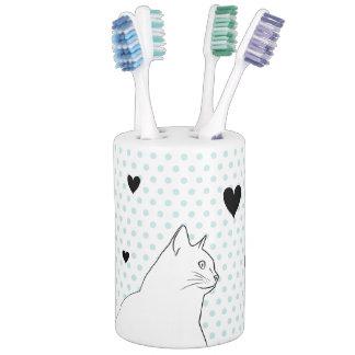 De lijntekening van de kat met stippen en harten tandenborstelhouder