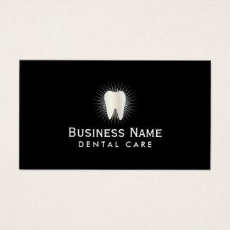 Dentaire professionnel rougeoyant d'icône de dent cartes de visite