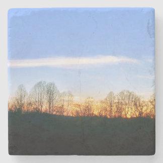 Dessous-de-verre En Pierre Coucher du soleil derrière des arbres