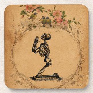 Dessous de verre squelettiques à genoux de liège