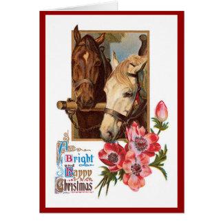 Deux chevaux - une carte de Noël lumineux et