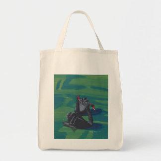 Deux cygnes noirs sur des sacs fourre-tout à