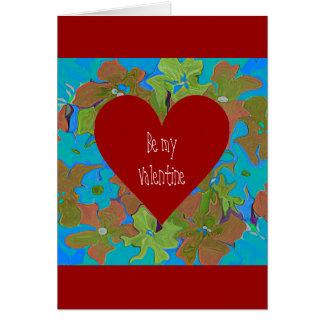 Dispositions florales de forme de coeur pour des carte