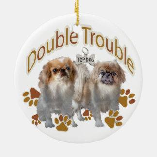 Double ornement de Noël de problème de Pekingese