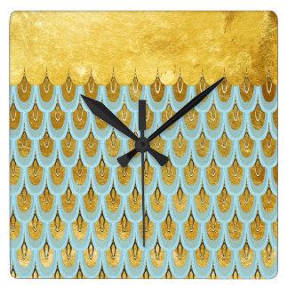 Échelles de poissons turquoises bleues brillantes horloge carrée