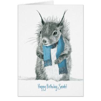 Écureuil drôle portant la carte de voeux bleue