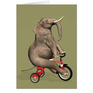Éléphant drôle montant un tricycle