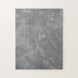 Encre blanche sur l'arrière - plan argenté puzzle