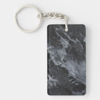 Encre noire et blanche sur le noir porte-clés