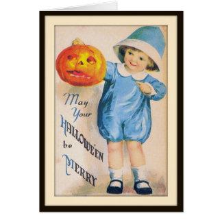Enfant avec la carte de lanterne de Halloween Jack