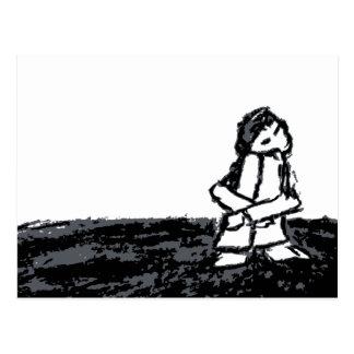 enfant faisant le coin cartes postales