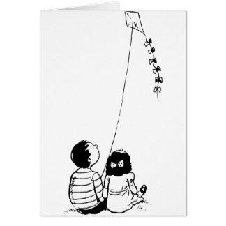 Enfants pilotant des cartes de voeux de