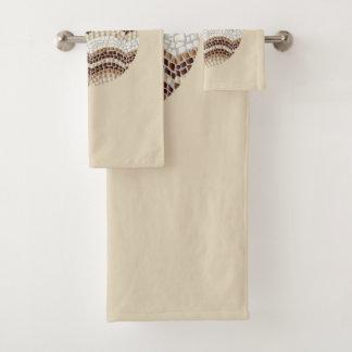 Ensemble beige rond de serviette de salle de bains