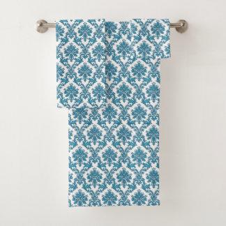 Ensemble floral de serviette de damassé de bleus