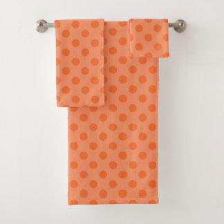 Ensemble orange de serviette de point de polka