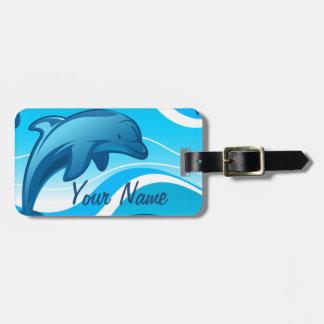 Étiquette À Bagage Les vagues sautantes de dauphin