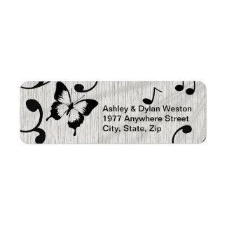 Étiquette Symboles de musique, papillon, feuille dans les