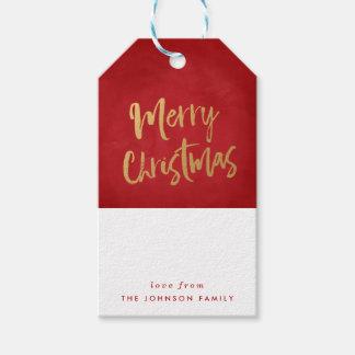 Étiquettes balayées de cadeau de Joyeux Noël d'or