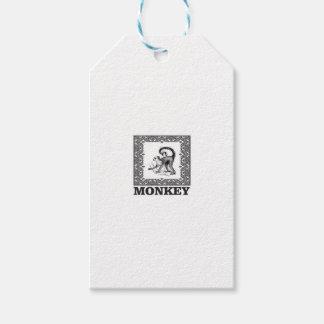 Étiquettes-cadeau singe dans une boîte