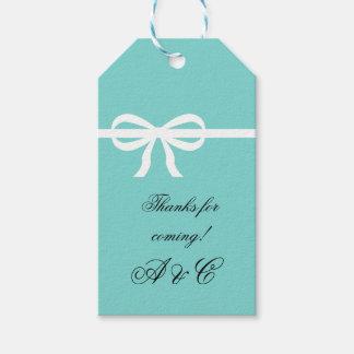 Étiquettes d'Aqua et de cadeau d'arc de blanc