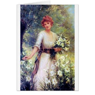 Femme avec la peinture de lis blancs carte de vœux