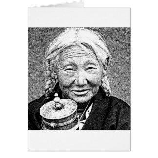Femme tibétaine avec la roue de prière carte