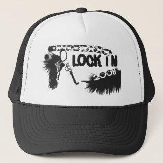 fermez à clef dans le casquette