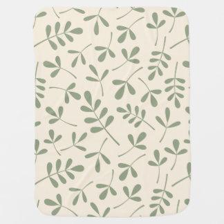 Feuille vert assorti sur le motif crème couverture pour bébé