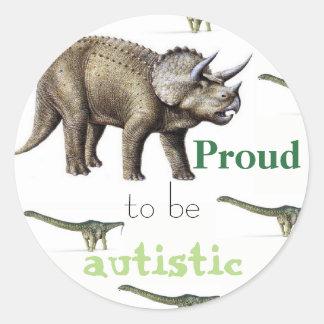 Fier d'être autocollant autiste de dinosaure