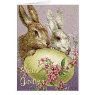 Fleur peinte colorée de rose d'oeufs de lapin de carte de vœux