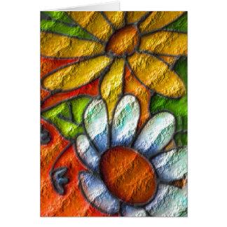 Fleurs sur la carte de voeux de mur de briques