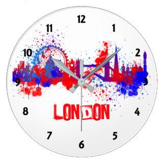Floc artistique bleu blanc rouge de peinture grande horloge ronde