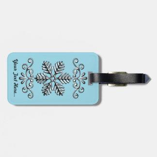 Flocon de neige mignon sur le bleu étiquette à bagage