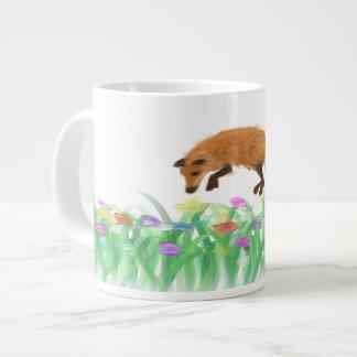 Fox sautant dans le pré sur une tasse