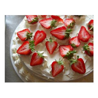 Fraises et carte postale crème de gâteau