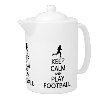 Gardez la théière du football de calme et de jeu
