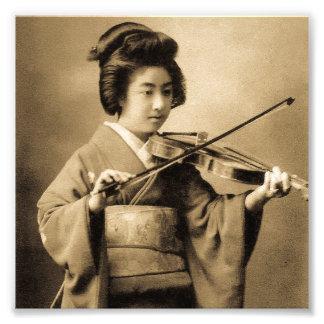 Geisha japonais vintage jouant le classique de photo d'art